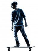 image of skateboarding  - one caucasian man skateboarder skateboarding  in silhouette isolated on white background - JPG