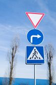 stock photo of beep  - Various road signs on a pole against the blue sky - JPG