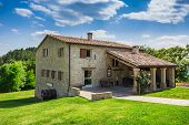 stock photo of farmhouse  - a Tuscan farmhouse in Italy - JPG