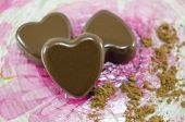 stock photo of decoupage  - Heart shaped chocolate candies on a decoupage plate with cocoa [[** Note: Shallow depth of field ** Note: Visible grain at 100%, best at smaller sizes - JPG