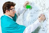 foto of conduction  - Young scientist conducting research - JPG