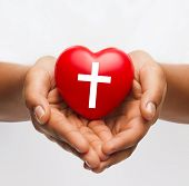 Постер, плакат: religion christianity and charity concept african american female hands holding red heart with ch