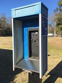 stock photo of phone-booth  - Abandoned public telephone booth - JPG