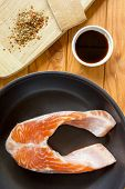 stock photo of soy sauce  - Trout fillet in a pan with spices and soy sauce. ** Note: Soft Focus at 100%, best at smaller sizes - JPG