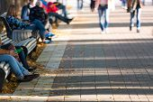 pic of pedestrians  - Motion blurred pedestrians in the park - JPG