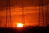 picture of transmission lines  - Electric power transmission lines at sunset outskirts of St - JPG