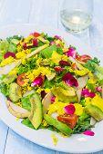 picture of hawaiian flower  - Hawaiian salad made with kale tomatoes avocado edible flowers and mango dressing - JPG
