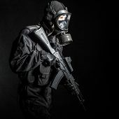 stock photo of anti-terrorism  - Russian special forces operator in black uniform and gas mask - JPG