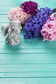 picture of blue angels  - Background with angel and fresh pink violet blue hyacinths on painted wooden planks - JPG