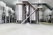 stock photo of wine cellar  - modern wine cellar with stainless steel tanks - JPG
