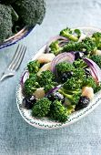 picture of olive shaped  - Broccoli and potatoes salad with olives and red onion on a beautiful plate elongated shape - JPG