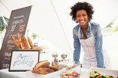 picture of marquee  - Female Bakery Stall Holder At Farmers Fresh Food Market - JPG
