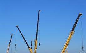 pic of boom-truck  - Truck crane boom on the blue sky background - JPG
