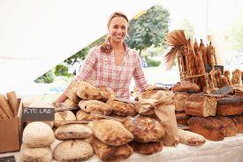 picture of stall  - Female Bakery Stall Holder At Farmers Fresh Food Market - JPG