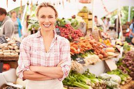 stock photo of stall  - Female Stall Holder At Farmers Fresh Food Market - JPG