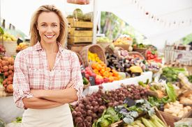 pic of stall  - Female Stall Holder At Farmers Fresh Food Market - JPG