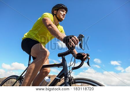 Biking man cycling on road