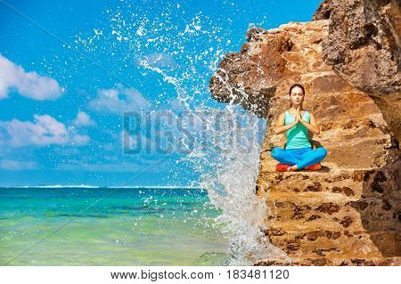 poster of Meditation on sea surf with splashes background. Active woman sit on beach rock and practicing yoga to keep fit and health. Healthy lifestyle fitness training sport activity on summer family holiday