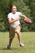 Boy Running With Football