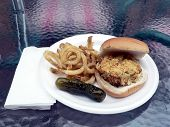 Crabcake Sandwich With Fries And Pickle