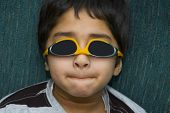 pic of rutin  - An young asian kid having fun with his goggles - JPG