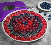 Berry Round Pie Tartlet Made From Assorted Red And Blue Berries poster