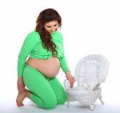 Pregnant Woman Kneeling