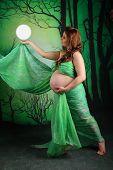 Pregnant Woman Wearing A Green Chiffon