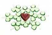 heart surrounded by clovers