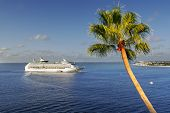 approaching cruise ship tropical island
