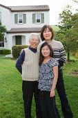 Grandmother, Mother, Daughter, Three Generations, Happy Family Portrait Outdoor in Front House