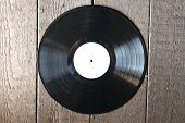 vinyl record on old wooden background