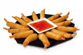big fried wonton tiger prawn springrolls with thai sweet chili sauce isolated on white background
