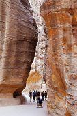 Tourists walking in Siq of worldwonder Petra in Jordan
