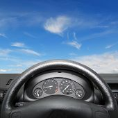pic of speeding car  - Wheel and dashboard of a car - JPG
