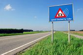 Speed checked by radar roadsign in rural landscape on empty road