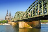 View on the 'dom' cathedral and the 'hohenzollern' railway bridge over river rhine in Cologne, Germa