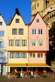 Colorful facade of the restaurants at St. Martin's church in Cologne, Germany