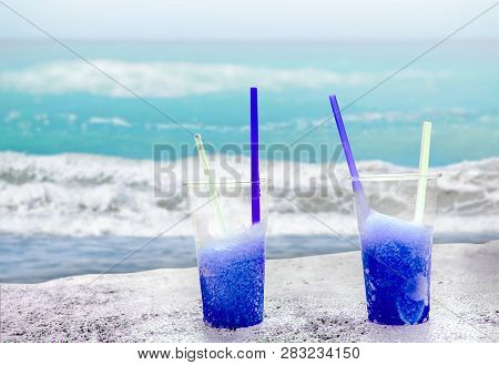 Two Blue Driftice With Straw