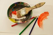 Wooden Painters Mixing Bowl With Wet Orange And White Paint Three Coloring Pencil Wet Paint Smeard O poster