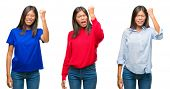 Collage of asian young woman standing over white isolated background angry and mad raising fist frus poster