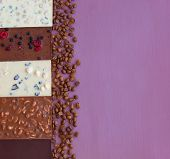 Chocolate On A Violet Background With Coffee Beans. Chocolate. Chocolate Bar. Nut Chocolate. Copy Sp poster