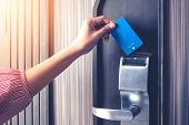 Hand Inserting Key Card To Unlock A Door Security Authentication In The Hotel Or Apartment Safeguard poster
