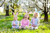 Easter Egg Hunt. Kids With Bunny Ears And Basket. poster