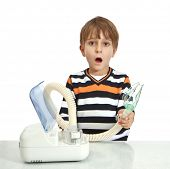 little boy makes inhalation with nebuliser