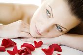 stock photo of beautiful face  - closeup of young beautiful female face lying on a bed maybe enjoying a beauty - JPG