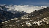 White towns under snowcovered hight mountains