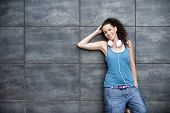 image of rap-girl  - Young happy sportive woman in urban background - JPG