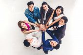 Top View Of Successful Of Group Business People Stack And Putting Their Hands Together At Office.fri poster