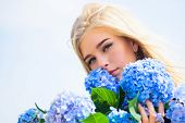 Tenderness Of Young Skin. Springtime Bloom. Girl Tender Blonde Hold Hydrangea Flowers Bouquet. Natur poster